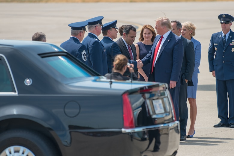 President Donald Trump greets leadership from the Kentucky Air National Guard as he arrives at the 123rd Airlift Wing in Louisville, Ky., Aug. 21, 2019. Trump was in town to speak at an AMVETS convention and attend a fundraiser for Kentucky Gov. Matt Bevin's re-election campaign. (U.S. Air National Guard photo by Phil Speck)