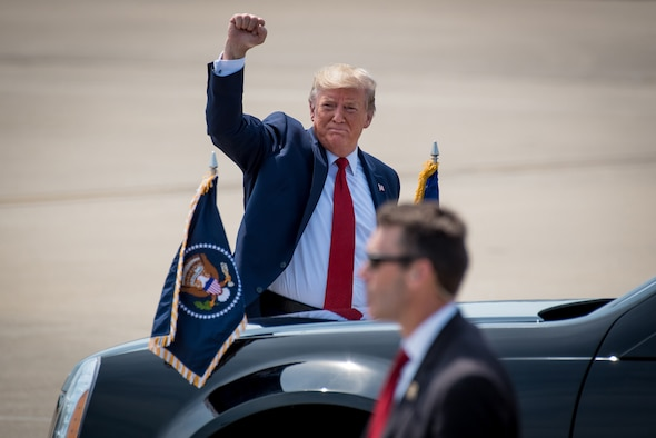 President Donald Trump greets supporters as he arrives at the Kentucky Air National Guard Base in Louisville, Ky., Aug. 21, 2019. Trump was in town to speak at an AMVETS convention and attend a fundraiser for Kentucky Gov. Matt Bevin's re-election campaign. (U.S. Air National Guard photo by Dale Greer)