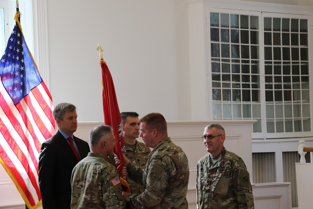 Transatlantic Division Commander Col. Christopher G. Beck passes the flag and command of the Middle East District to Col. Philip M. Secrist III during the Change of Command Ceremony on Thursday, 22 Aug 2019, at the Old Court House in Winchester, Va. Former Commander Col. Stephen H. Bales, Director of Programs Tom Waters and Deputy Commander Lt. Col. Richard Collins also took part in the flag passing ceremony