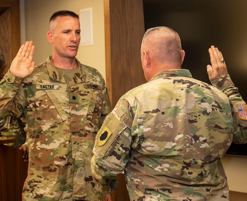 Lt. Col. Loren Easter recites the oath of office following his promotion.