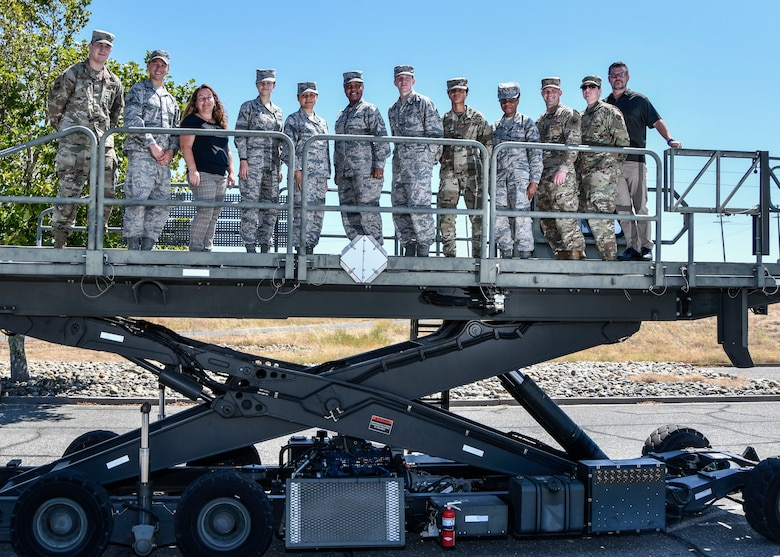 The 9th Logistics Readiness Squadron Individual Deployment Readiness Cell team poses for a group photo at Beale Air Force Base, California, August 1, 2019. (U.S. Air Force photo by Tech. Sgt. Alexandre Montes)