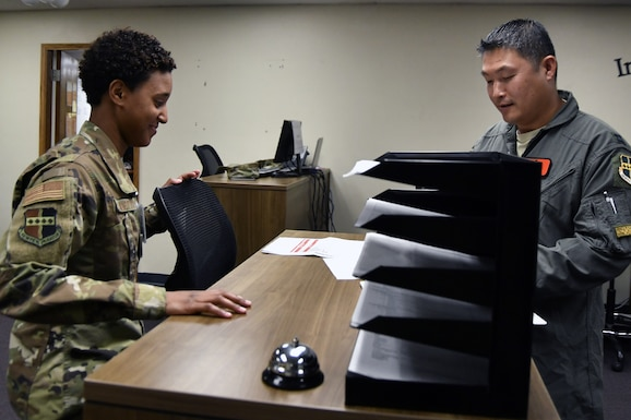 Senior Airman Ashlyee Alston, 9th Force Support Squadron relocations technician, assists an airmen from the 12th Reconnaissance Squadron with a deployment out-processing checklist at Beale Air Force Base, California, August 19, 2019. Beale AFB's Individual Deployment Readiness Cell has a team of roughly 23 Airmen and civilians comprised of logistics planners from the 9th Logistics Readiness Squadron, personnel specialist from the 9th Force Support Squadron, and an Installation Deployment Officer. (U.S. Air Force photo by Tech. Sgt. Alexandre Montes)
