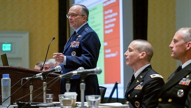 U.S. Air Force Maj. Gen. Lee Payne, assistant director of DHA's Combat Support Agency, moderates a panel presentation on Wednesday, August 21 at MHSRS. (MHS photo)