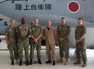 U.S. Navy Fleet Command Master Chief Rick O'Rawe poses for a photo with a group of chief petty officer selects in front of a Japanese MV-22 Osprey at Marine Corps Air Station New River, N.C., Aug. 19, 2019. O'Rawe was talking to Sailors about the training and schooling they have received so far from the instructors. (U.S. Marine Corps photo by Lance Cpl. Samuel Lyden)