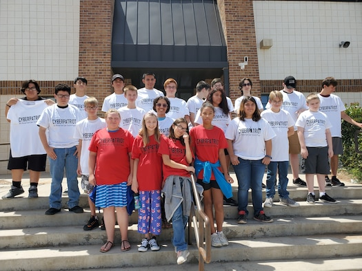 Cyber Patriot Camp participants show off their hard-earned t-shirts. (U.S. Air Force photo by Dwight Harp)