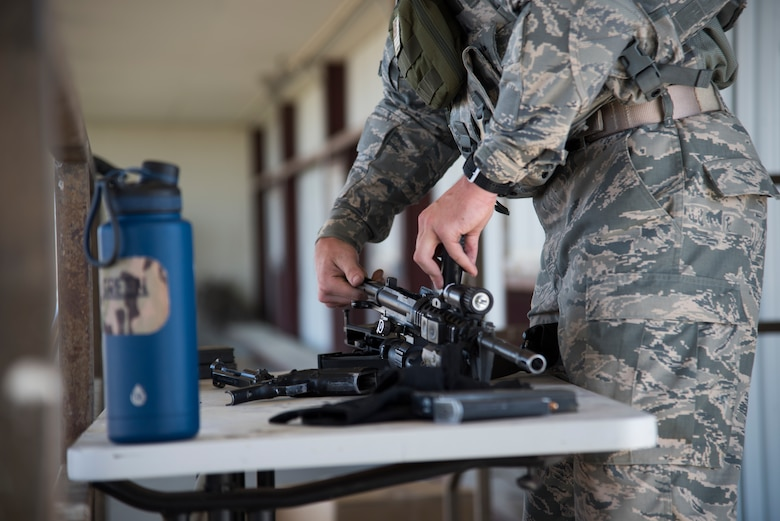 U.S. Air Force A1C Jesse Antal, 366th Security Forces Squadron response force member, assembles a M4A1 carbine August 16, 2019, at the off-base small arms range near Mountain Home Air Force Base, Idaho. Assembling the M4A1 carbine is a requirement to join the EST. (U.S. Air Force photo by Airman Natalie Rubenak)