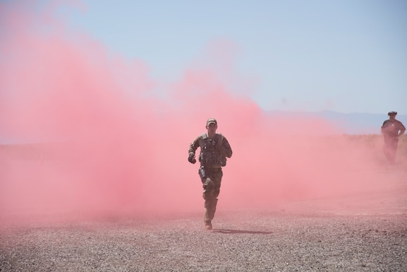 U.S. Air Force A1C Jacob Bailey, 366th Security Forces Squadron response force leader, runs through a smoke bomb August 16, 2019, at the off-base small arms range near Mountain Home Air Force Base, Idaho. The candidates ran four 50-meter runs through the smoke. (U.S. Air Force photo by Airman Natalie Rubenak)