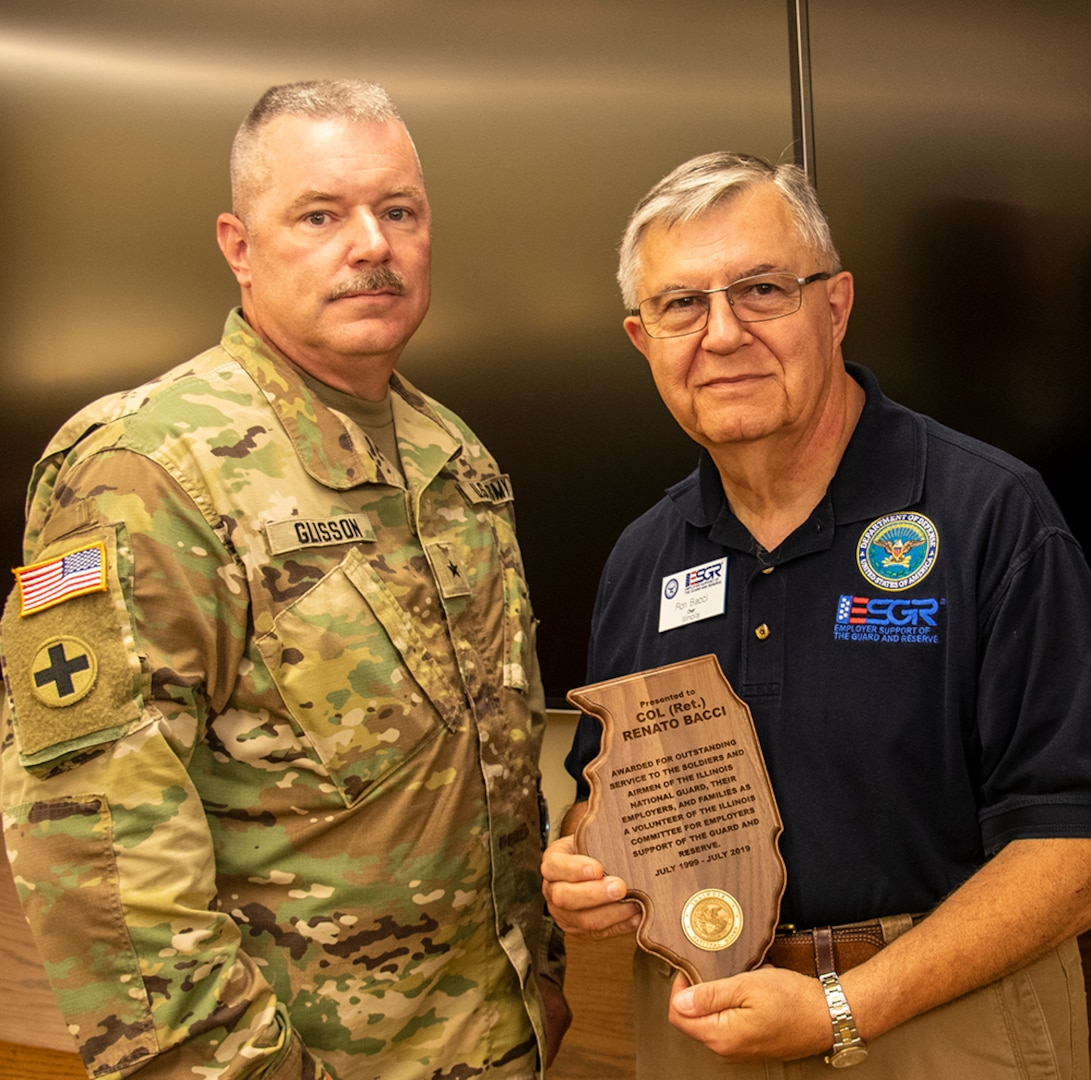 "Brig. Gen. Michael J. Glisson, Director, Illinois National Guard Joint Staff, presents Col. (Ret.) Renato ""Ron"" Bacci, of Wood Dale, Illinois, with the Illinois National Guard Outstanding Service Award for 20 years of volunteer service with the Employers Support of the Guard and Reserve program."