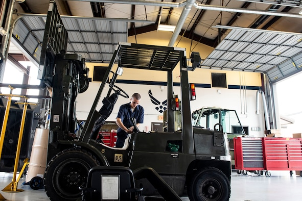 Airman 1st Class Alex Romero, 23d Logistics Readiness Squadron fire truck maintenance apprentice, performs maintenance on a forklift Aug. 22, 2019, at Moody Air Force Base, Ga. Vehicle Maintenance is responsible for servicing more than 400 vehicles on base, which allows Moody operations to maintain their pace. (U.S. Air Force photo by Senior Airman Erick Requadt)