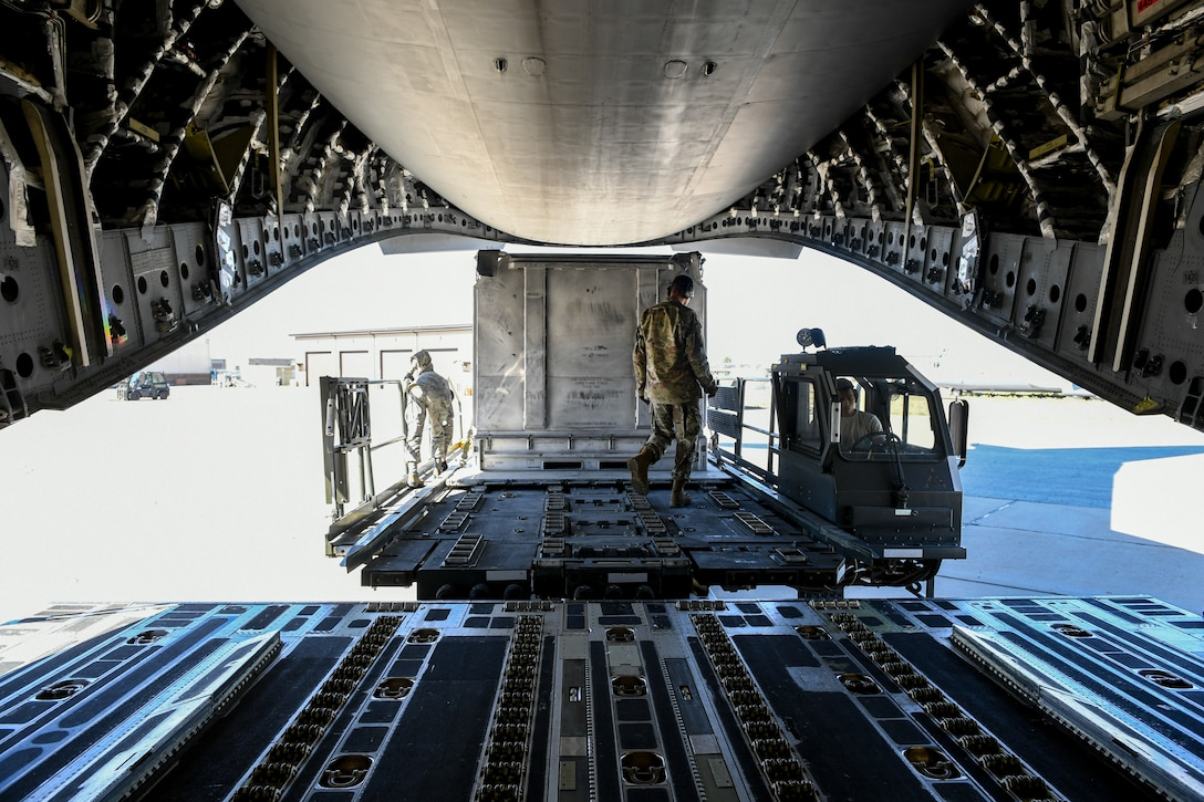 Airmen with the 75th Logistics Readiness Squadron unload cargo from a C-17 Globemaster III at Hill Air Force Base, Utah, Aug. 9, 2019. The C-17 is attached to the Reserve 89th Airlift Squadron assigned to the 445th Aircraft Wing out of Wright-Patterson AFB, Ohio. (U.S. Air Force photo by Cynthia Griggs)