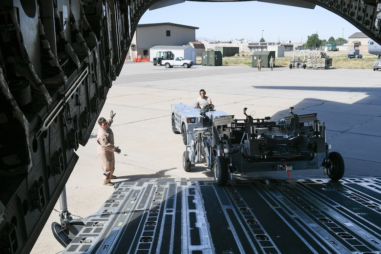 Senior Airman DeShain Calloway, 75th Logistics Readiness Squadron, unloads cargo from a C-17 Globemaster III at Hill Air Force Base, Utah, Aug. 9, 2019, with guidance from loadmaster Senior Master Sgt. Denise Roberts, 89th Airlift Squadron. The Reserve 89th AS is assigned to the 445th Aircraft Wing out of Wright-Patterson AFB, Ohio. (U.S. Air Force photo by Cynthia Griggs)