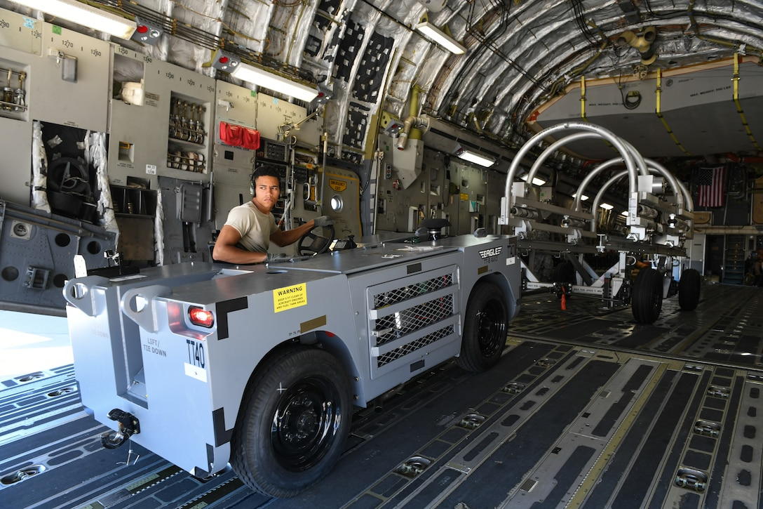 Senior Airman DeShain Calloway, 75th Logistics Readiness Squadron, unloads cargo from a C-17 Globemaster III at Hill Air Force Base, Aug. 9, 2019. The C-17 is attached to the Reserve 89th Airlift Squadron assigned to the 445th Aircraft Wing out of Wright-Patterson AFB, Ohio. (U.S. Air Force photo by Cynthia Griggs)