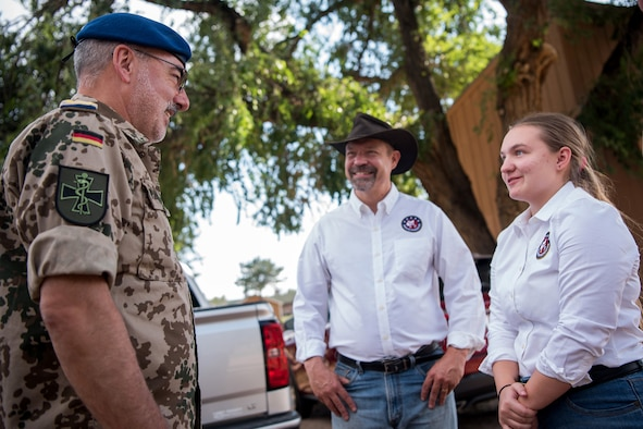 Lt. Gen. Ulrich Baumgaertner, surgeon general of the German armed forces, visits representatives from the Warrior Wellness program at the U.S. Air Force Academy equestrian center, Aug. 20, 2019. The program features equine therapy to promote self-confidence, problem solving, and improved mood through supervised interactions with horses  (U.S. Air Force photo/Trevor Cokley)