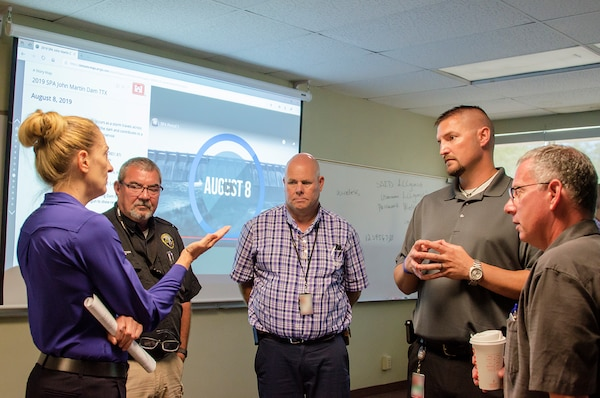 Shelley Dragomir, dam safety program manager (left), and Jeff Daniels, chief, Readiness and Contingency Operations (right), both from USACE-Albuquerque District, discuss future coordination efforts with stakeholders during the exercise at Lamar Community College August 15, 2019. Stakeholders (l-r): Rex Beemer, emergency manager, Kansas; Ralph Goodnight, emergency manager, Kansas and Jerrad Webb, emergency manager, Kansas.