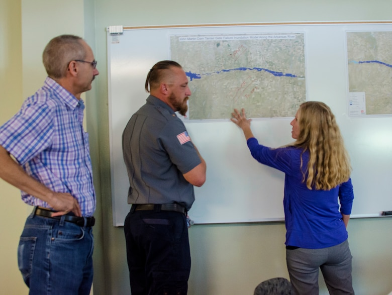 Mark Yuska, chief, Operations (left), and Amy Louise, Arkansas River Basin manager, both USACE-Albuquerque District, discuss inundation with Jeremy Burkhart, chief and emergency manager, Lamar Fire Department, during the exercise at Lamar Community College August 15, 2019.