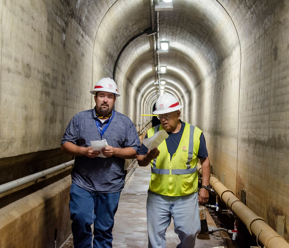 Camillo Chavarria, maintenance mechanic, John Martin Dam, USACE-Albuquerque District (right), discusses the operation of John Martin Dam with Riley Frazee, emergency manager, Colorado, during a tour of the dam following the exercise at Lamar Community College August 15, 2019.