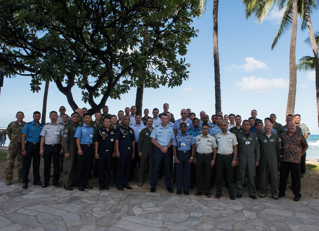 Attendees at the Indo-Pacific Safety Air Forces Exchange take a group photo in Waikiki, Hawaii, Aug. 20, 2019.