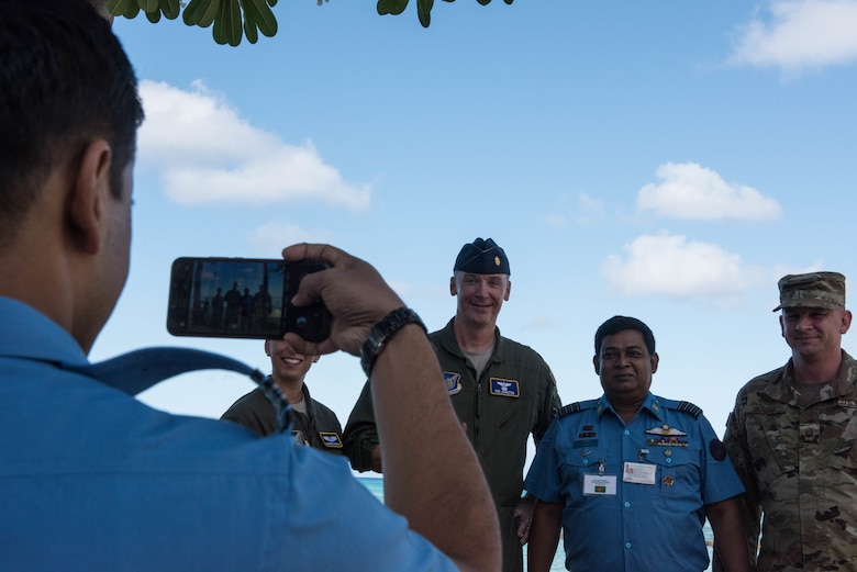 United States Air Force Airmen take a photo with a member from the Bangladesh Air Force during the Indo-Pacific Safety Air Forces Exchange in Waikiki, Hawaii, Aug. 20, 2019.