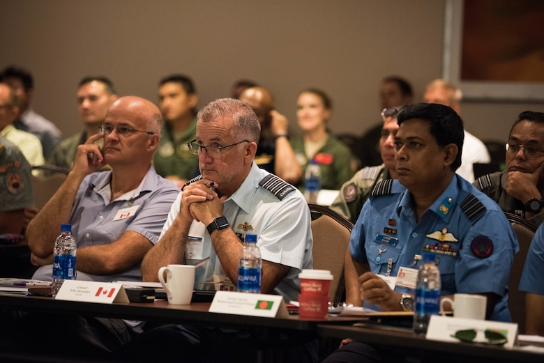 Attendees at the Indo-Pacific Safety Air Forces Exchange listen to a briefing on proactive aviation safety in Waikiki, Hawaii, Aug. 20, 2019.