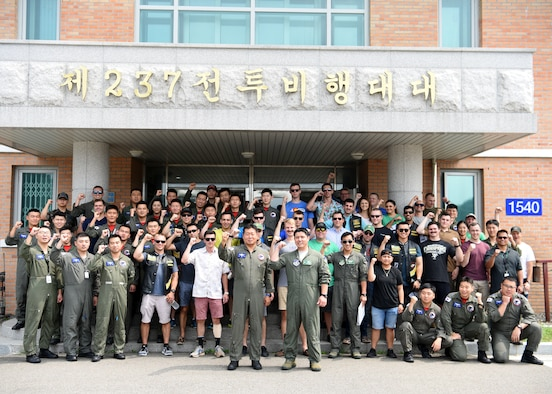 """Members of the 25th Fighter Squadron at Osan Air Base, Republic of Korea, and the 237th and 103rd FS's at Wonju AB, ROK pose for a group photo during a during a """"friendship day"""" visit August 21, 2019. This """"friendship day"""" allowed the U.S. and ROKAF military members the opportunity to integrate and strengthen their relationships. (U.S. Air Force photo by Staff Sgt. James L. Miller)"""