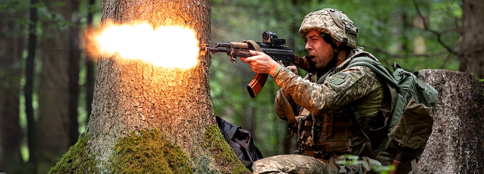 A Ukrainian mechanized infantry soldier fires at Opposing Forces (OPFOR) trying to advance forward, during the culminating force on force exercise of Combined Resolve XII at the Joint Multinational Readiness Center in Hohenfels, Germany Aug. 19, 2019.