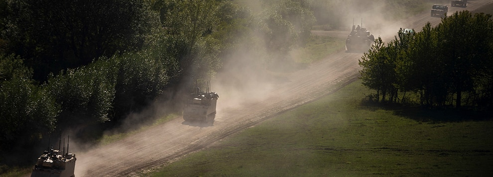 "U.S. Army vehicles with 1st Armored Brigade Combat Team, 1st Infantry Division, convoy to their position in ""the box"" during the culminating force on force exercise of Combined Resolve XII at the Joint Multinational Readiness Center in Hohenfels, Germany Aug. 19, 2019."