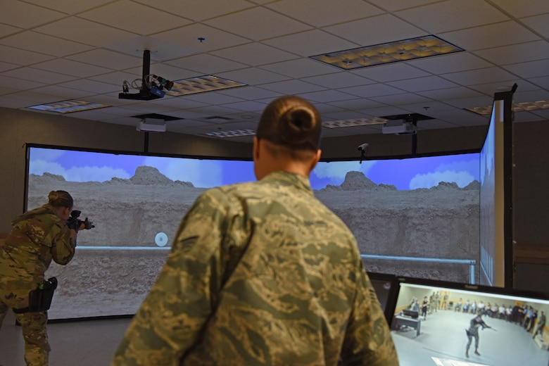 The 8th Security Forces Squadron provide a virtual reality weapons demonstration for the Korean National Police Gunsan City branch at Kunsan Air Base, Republic of Korea, Aug. 20, 2019. The KNP received the chance to see how the 8th SFS train on the system and were able to test it out themselves. (U.S. Air Force photo by Staff Sgt. Joshua Edwards)