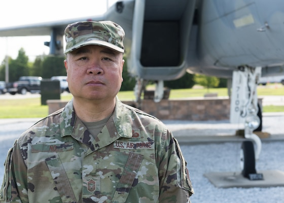 Chief Master Sgt. Wing Ng of the 102nd Intelligence Wing poses beside the F-15 he launched on Sept. 11, 2001.
