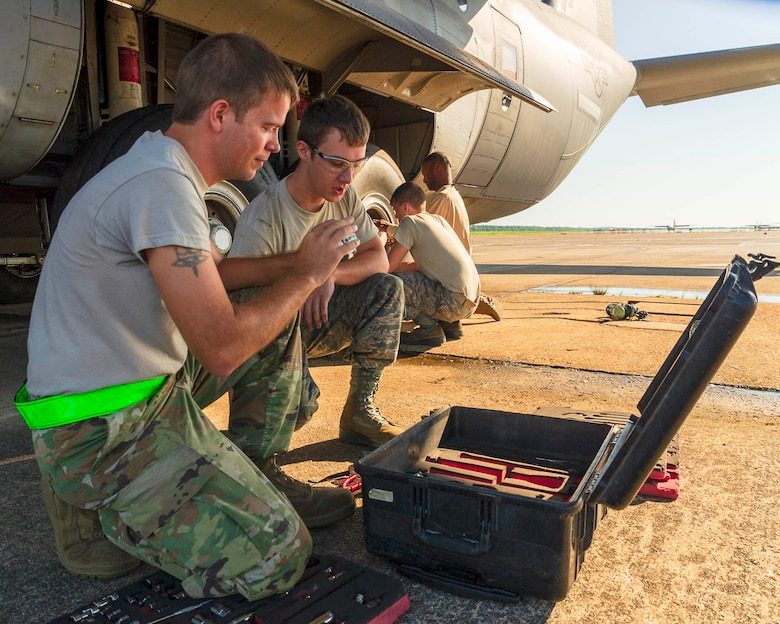 Air Force Reserve Airmen from the 913th Maintenance Squadron work with 19th Airlift Wing active duty members to troubleshoot the landing gear of a C-130J Hercules on August 15, 2019, at Little Rock Air Force Base, Ark.  There are 20 Reserve members who work with Team Little Rock maintenance personnel to ensure combat airlift is available. Mobility aircraft, such as the C-130J, deliver critical personnel and cargo and provide airdrop of time-sensitive supplies, food and ammunition on a global scale. A critical part of the airlift capabilities are the efforts of the maintenance personnel who ensure the workhorse of the mobility force, the C-130, is always ready, always there! (U.S. Air Force Reserve photo by Maj. Ashley Walker)