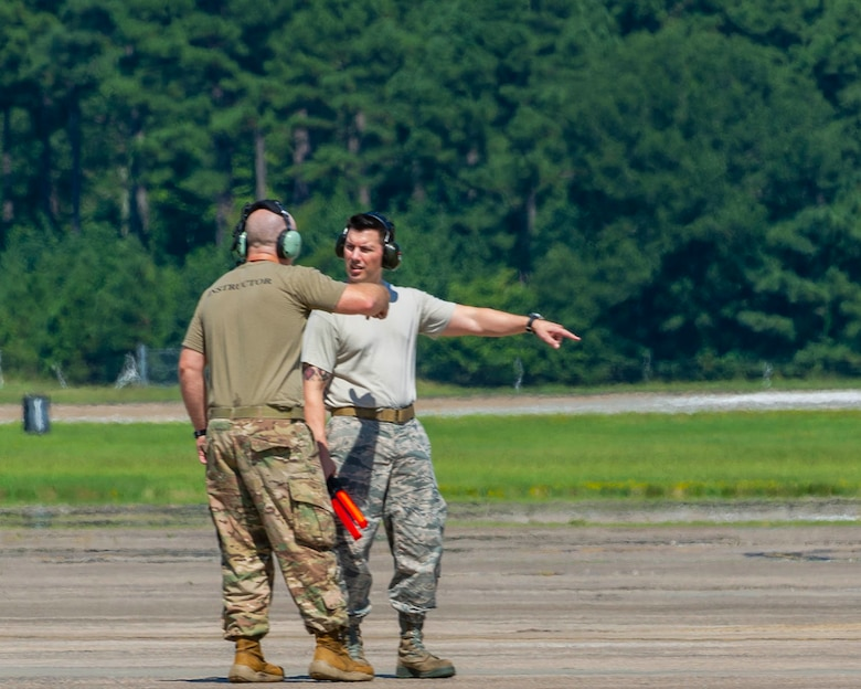 Team Little Rock personnel train on the proper taxi procedures as they prepare a C-130J Hercules for takeoff on August 15, 2019, at Little Rock Air Force Base, Ark. There are a multitude of maintenance career fields collaborating to certify the aircraft are safe and ready to meet training and operation requirements. The 913th Airlift Group was first assembled in July 2014 as a classic association with the 19th Airlift Wing. Since then, we have leveraged on our Total Force partners to hone our combat airlift tactics. (U.S. Air Force Reserve photo by Maj. Ashley Walker)
