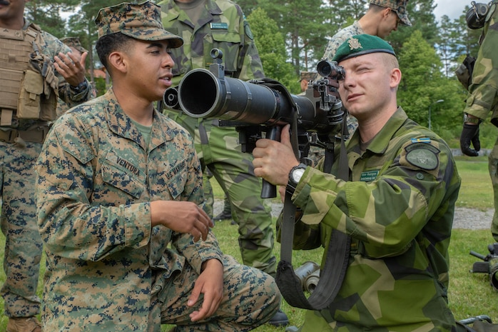 U.S. Marines with 1st Battalion, 8th Marines, Marine Rotational Force–Europe 19.2 and Swedish Marines from 1st Marine Regiment, learn about each other's display their equipment and weapon systems in Berga Naval Base, Sweden, Aug. 19, 2019. Archipelago Endeavor 19 is an annual bilateral integrated field-training exercise, conducted to promote interoperability, strengthen partnerships, and enhance strategic and tactical cooperation between U.S. and Swedish Marines.