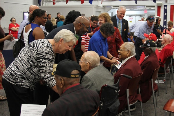 Members of Joint Base San Antonio and the San Antonio community greet and thank World War II Veterans after a ceremony honoring their service and sacrifice at the Military and Family Readiness Center at Joint Base San Antonio-Fort Sam Houston Aug. 20. The ceremony was hosted by the FSH Survivor Outreach Services Support Program in partnership with the FSH Gold Star Families as a way to honor the WWII veterans who were unable to travel to France for the 75th Anniversary of D-Day.