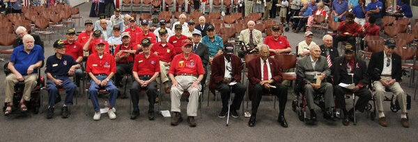 World War II veterans gather for a group photo after a ceremony honoring their service and sacrifice at the Military and Family Readiness Center at Joint Base San Antonio-Fort Sam Houston Aug. 20. The ceremony was hosted by the FSH Survivor Outreach Services Support Program in partnership with the FSH Gold Star Families as a way to honor the WWII veterans who were unable to travel to France for the 75th Anniversary of D-Day.