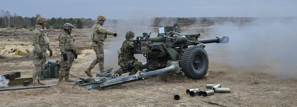 Czech Staff Sgt. Radim Hava direct fires a M119 105 mm howitzer with U. S. paratroopers assigned to A Battery, 4th Battalion, 319th Airborne Field Artillery Regiment, 173rd Airborne Brigade at the culmination of exercise Dynamic Front 19 at Torun, Poland, March 8, 2019.