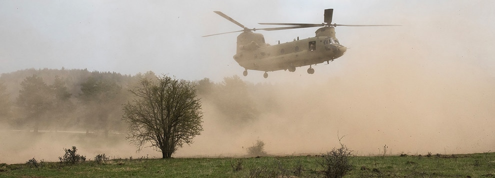 A U.S. Army CH-47 Chinook helicopter assigned to the 1st Infantry Division's 1st Combat Aviation Brigade prepares to land in a field during exercise Allied Spirit X before conducting light, tactical, all-terrain vehicles training with Special Operations Forces in Hohenfels, Germany April 13, 2019.