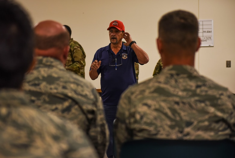 Guy Conley, 92nd Security Forces Squadron plans and programs chief, gives a brief to incoming Exercise Mobility Guardian 2019 personnel August 16, 2019, at Fairchild Air Force Base, Washington.