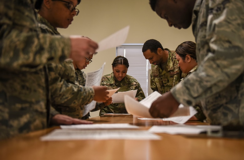 Members of Team Fairchild check paperwork for incoming personnel participating in Exercise Mobility Guardian 2019 at Fairchild Air Force Base, Washington, Aug 16, 2019.
