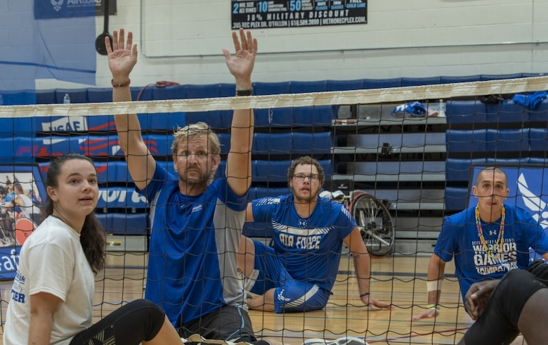 Wounded warriors play volleyball.