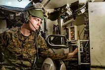 """Lance Cpl. Hunter Lemaster, a ground electronics transmissions systems maintainer with 2nd Tanks Battalion, 2nd Marine Division, poses for a photo at Camp Lejeune, N.C., Aug. 21, 2019. """"A good leader is able to listen to, and help figure out, the problems of the Marines under your charge as well as guide them in the right direction and teach them the skills you know,"""" said Lemaster, a Cordoba, Ill. native. Lemaster completed limited technical inspections on 14 M1A1 tanks and four high mobility multipurpose wheeled vehicles, as well as successfully working on millions of dollars-worth of Marine Corps assets in preparation for the upcoming Marine Air-Ground Task Force war-fighting exercise. (Courtesy photo)"""
