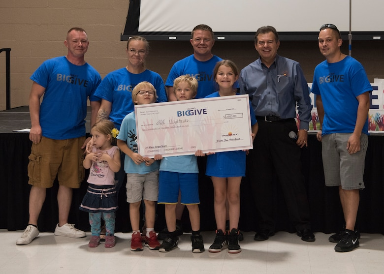 Members of team ACE Knight Hawks accept a check for winning 2nd place in the large team category as part of the 2019 Alamo's Big Give closing ceremony, August 22, at the Willie Estrada Civic Center in Alamogordo, N.M. This was the 12th year of Alamo's Big Give which has saved the Otero community over $2,000,000 through community service. (U.S. Air Force photo by Staff Sgt. BreeAnn Sachs)