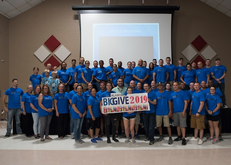 Volunteers with the 2019 Alamo's Big Give pose for a photo during the closing ceremony, August 22, in the Willie Estrada Civic Center in Alamogordo, N.M. This was the 12th year of Alamo's Big Give which has saved the Otero community over $2,000,000 through community service. (U.S. Air Force photo by Staff Sgt. BreeAnn Sachs)
