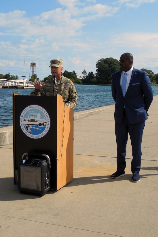 Col. Aaron Reisinger, commander and district engineer of the U.S. Army Corps of Engineers Chicago District, speaks during a ribbon cutting ceremony hosted by the Waukegan Harbor and Marina to reopen the Waukegan South Pier for public use Aug. 22 while Sam Cunningham, mayor of Waukegan, looks on. The Corps removed deteriorated concrete, placed new concrete and added nine new access ladders. (U.S. Army photo by Rita Keefe/Released)