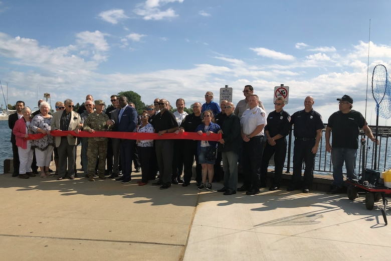 The U.S. Army Corps of Engineers Chicago District participated in a ribbon cutting ceremony hosted by the Waukegan Harbor and Marina to reopen the Waukegan South Pier in Waukegan, Illinois, for public use Aug. 22. The Corps removed deteriorated concrete, placed new concrete and added nine new access ladders. (U.S. Army photo by Rita Keefe/Released)