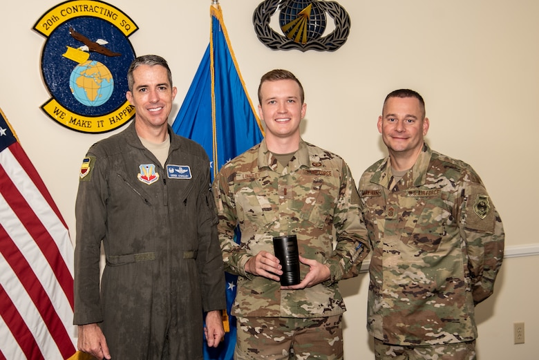 U.S. Air Force Col. Derek O'Malley, 20th Fighter Wing commander, left, 2nd Lt. Jordan Lindley, 20th Contracting Squadron contract specialist, center, and Chief Master Sgt. Jason Morehouse, 20th Fighter Wing command chief, stand for a photo as Lindley is recognized as Weasel of the Week (WOW) at Shaw Air Force Base (AFB), South Carolina, Aug. 8, 2019.