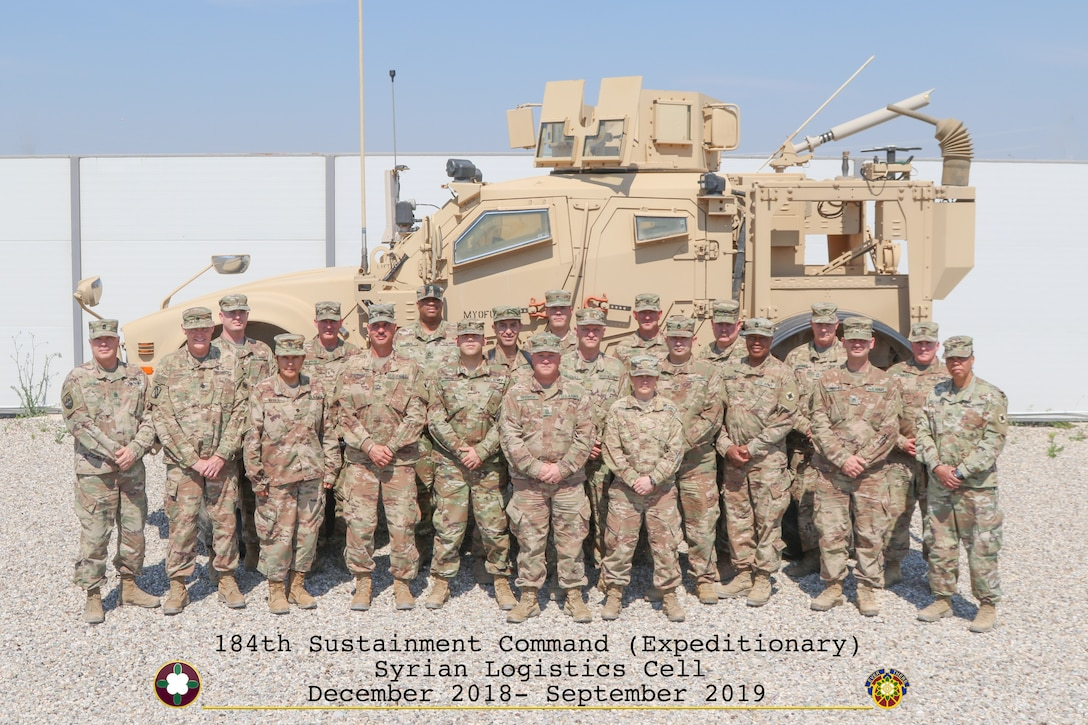 Members of the 1st Theater Sustainment Command's Syrian Logistics Cell stand for a group photo in Erbil, Iraq.