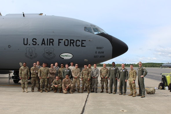 U.S. Air Force Airmen stand with a recovered KC-135 Stratotanker Aug. 4, 2018, at Bangor Air National Guard Base, Maine.