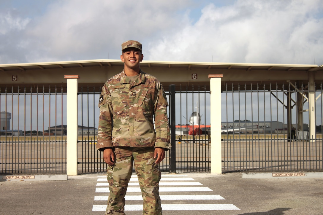 """U.S. Air Force 2nd Lt. Isaac Perez stands outside the flight line at Joint Base San Antonio-Randolph 24 Aug. 20, 2019. Perez, who is awaiting the start of version three of """"Pilot Training Next,"""" was the 2019 winner of the Intercollegiate Tennis Association's national Arthur Ashe Jr. Leadership and Sportsmanship award. (U.S. Air Force photo by 2nd Lt. Robert Guest)"""