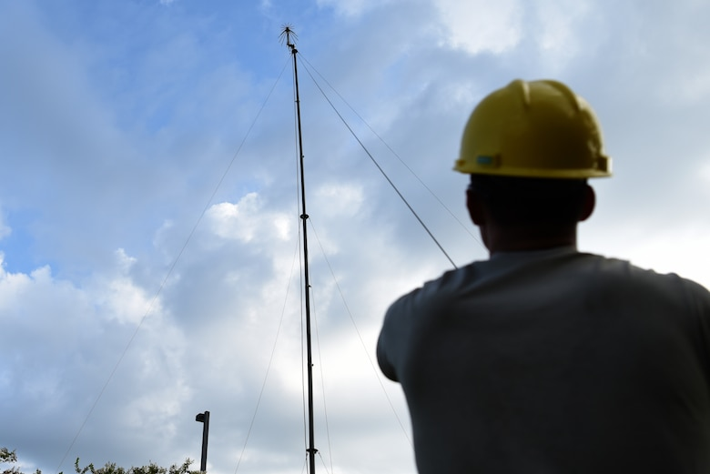U.S. Air Force Airman 1st Class Branden Wright, 338th Training Squadron Radio Frequency Transmission Systems student, helps set up an ultra high frequency antenna outside of Jones Hall on Keesler Air Force Base, Mississippi, August 12, 2019. The RF Transmission System course is a 653 hour course where students learn line-of-sight communication, high frequency operations, satellite communications and systems and more. (U.S. Air Force photo by Senior Airman Suzie Plotnikov)
