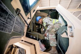Sgt. 1st Class Roy Carson, maintenance quality assurance for wheeled vehicles, 401st Army Field Support Battalion-Kuwait, completes an inspection of a military supply truck Aug. 10 at Army Prepositioned Stocks-5, Camp Arifjan, Kuwait.