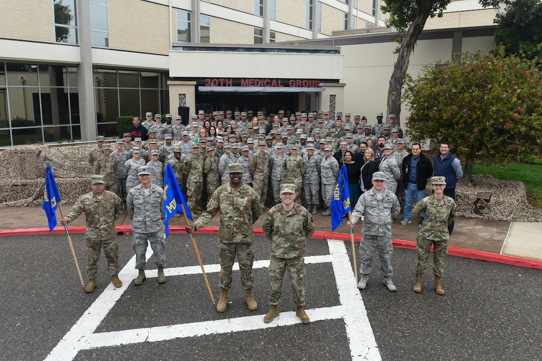 The 30th Medical Group officially stood up two new health care squadrons during an activation and re-designation ceremony Aug. 23, 2019, at Vandenberg Air Force Base, Calif. Under the reorganization, all Active Duty military will be seen by providers in the 30th Operational Medical Readiness Squadron, which was re-designated from the 30th Medical Operations Squadron, while all dependents and retirees will be seen by providers in the newly activated 30th Health Care Operations Squadron following the deactivation of the 30th Medical Support Squadron. (U.S. Air Force photo by Michael Peterson)